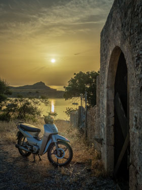 Scooter at sunrise in Lindos on the Greek Island of Rhodes