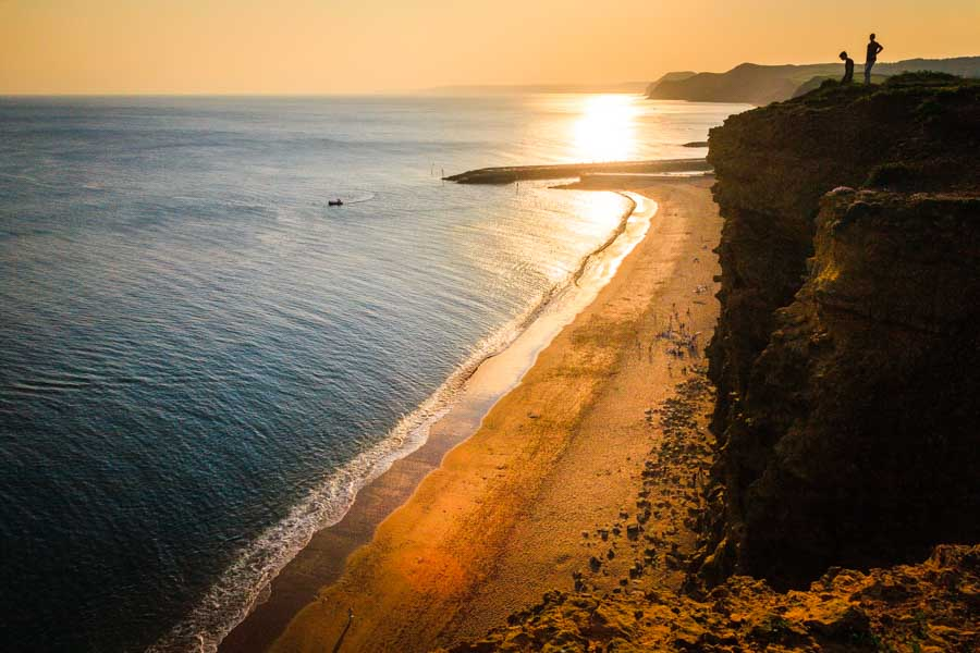 The view from the cliffs overlooking the beach at West Bay at su