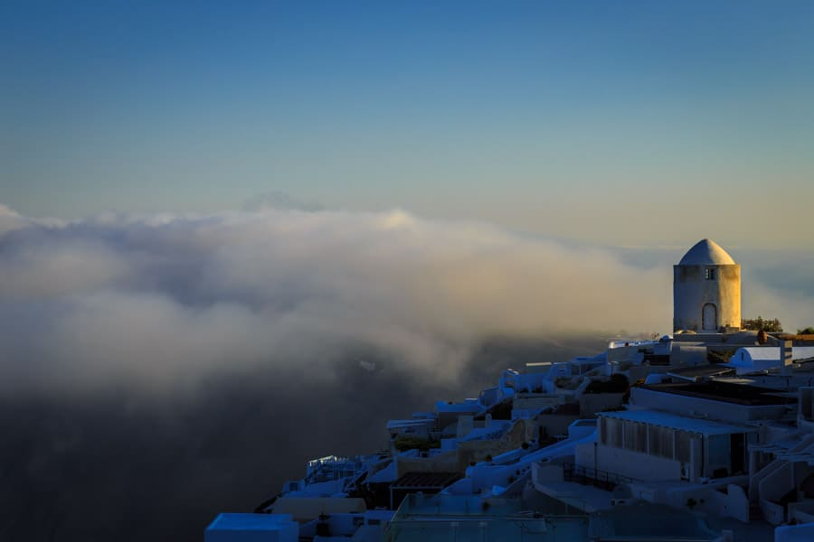 Iconic view of a Santorini windmill at sunrise