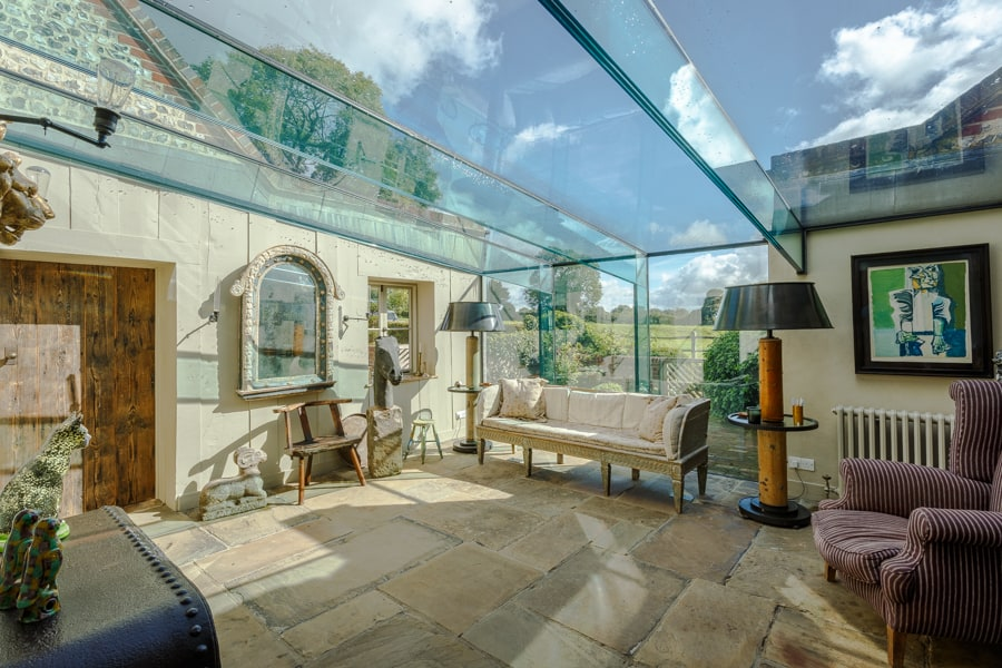 A stylish new living space with a glass wall and roof photograph